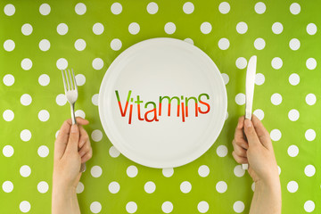 Woman eating vitamins, top view
