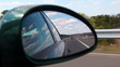 Highway view on side mirror of a car