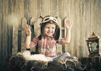 Happy kid playing in pilot helmet