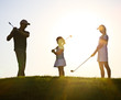 Family of a golfers at sunset