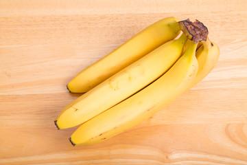 Small Bunch of Yellow Bananas on Wood Table