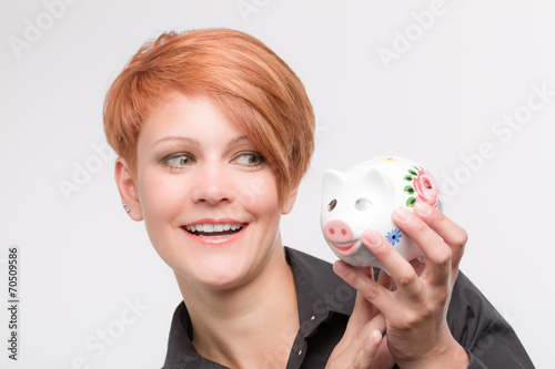 canvas print picture Junge Frau mit Sparschwein