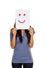 Frau hält Smiley vor gesicht