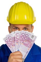 Handwerker mit Geldscheinen
