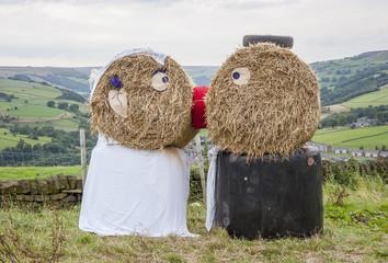 straw bail wedding couple