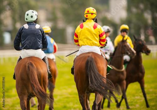 Fotobehang Paardrijden horse riders on the race track