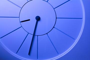 Closeup photo of a blue simple clock.