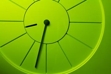 Closeup photo of a green simple clock