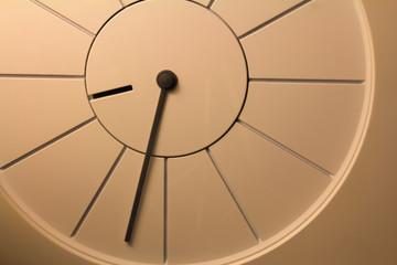 Closeup photo of a simple clock.