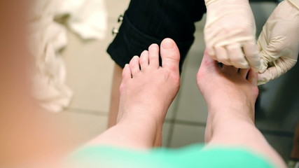 Female feet under pedicure