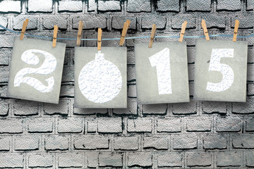 Snow-covered paper numbers of new 2015 with snow on abstract bac