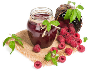 Glass jar of raspberry jam.