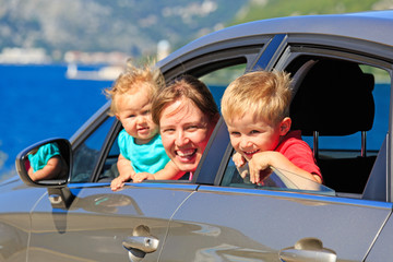 family travelling by car on sea vacation