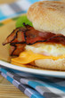 Muffin with fried egg, bacon and cheese