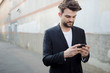 handsome hipster modern man using smart phone