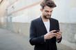handsome hipster modern man using smart phone