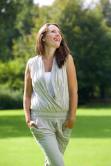 Woman smiling outdoors in the countryside