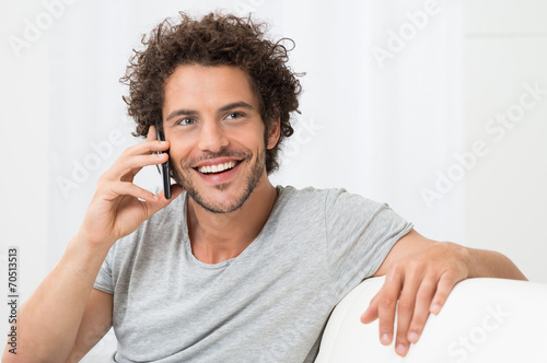 Young Man Talking On Cellphone - 70513513