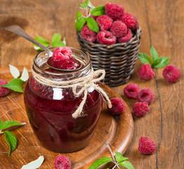 jar of raspberry jam and  fresh berries