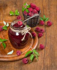 spoon in jar of raspberry jam