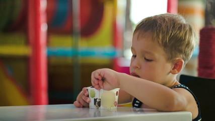 Little boy eating chocolate ice cream