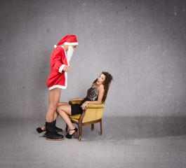 maniac santa claus with gift for a girl