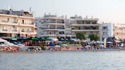 Summer resort with people resting on beach