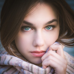 Portrait of a young woman with blue eyes. Color toned image.
