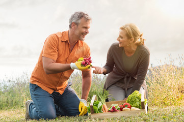 Mature Couple Cultivating Vegetables