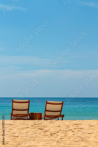 Leinwanddruck Bild empty sunbeds on a gorgeous sandy beach
