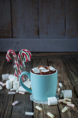 Mug filled with hot chocolate and marshmallow  and candy canes i