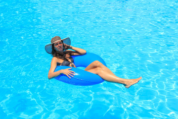 girl in bikini and hat is in the water