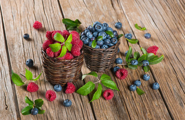 blueberries and raspberries in a baskets