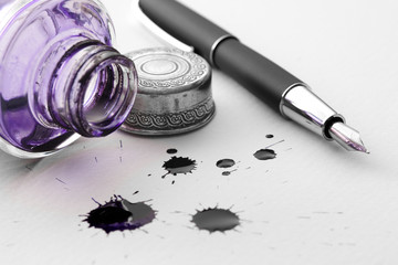 Pen, inkwell and inkblots