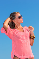 Girl on beach wearing pink top