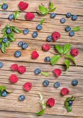 View from above of fresh berries on wooden table