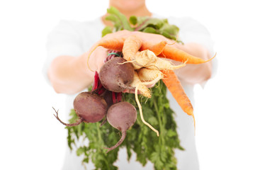 Midsection of a woman holding vegetables