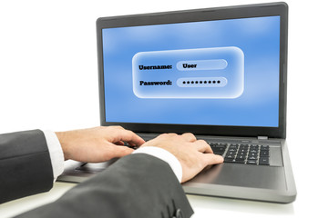 Businessman logging in on a laptop computer