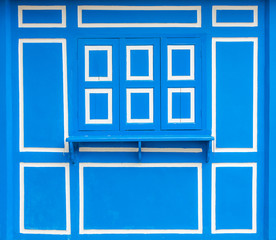 Design of blue wooden window and wall