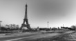 Traffic flows in Paris night. Tour Eiffel at dusk