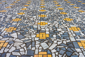 The art of mosaic pavement from broken ceramic tiles