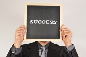 """Businessman with message """"success"""""""