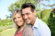 Portrait of happy mature couple in backyard