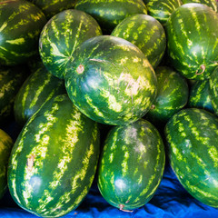 Watermelons on a market.  Heap of watermelons.