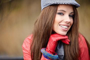 Portrait of a beautiful brunette girl in  in park. Warm sunny da