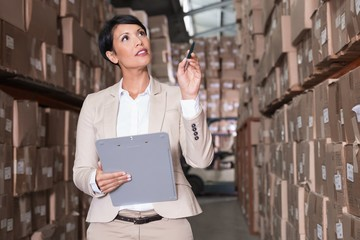 Warehouse manager checking her inventory