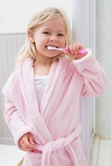Cute girl brushing her teeth
