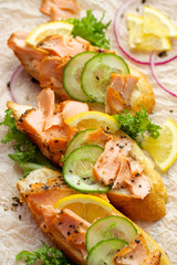 Sandwiches with smoked salmon, fresh cucumber and  lemon