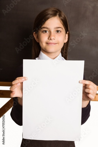 canvas print picture Cute pupil showing white page