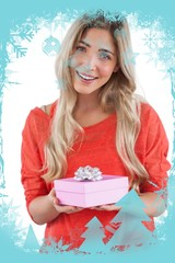 Composite image of blonde woman receiving a gift